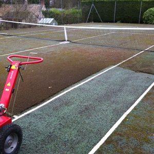 Artificial turf tennis court maintenance